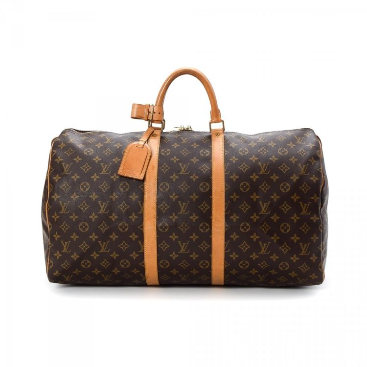6373f1a7df88 ... vintage Louis Vuitton Keepall 55 travel bag is guaranteed by LXRandCo.  This everyday weekend bag in beautiful brown is made in monogram coated  canvas.