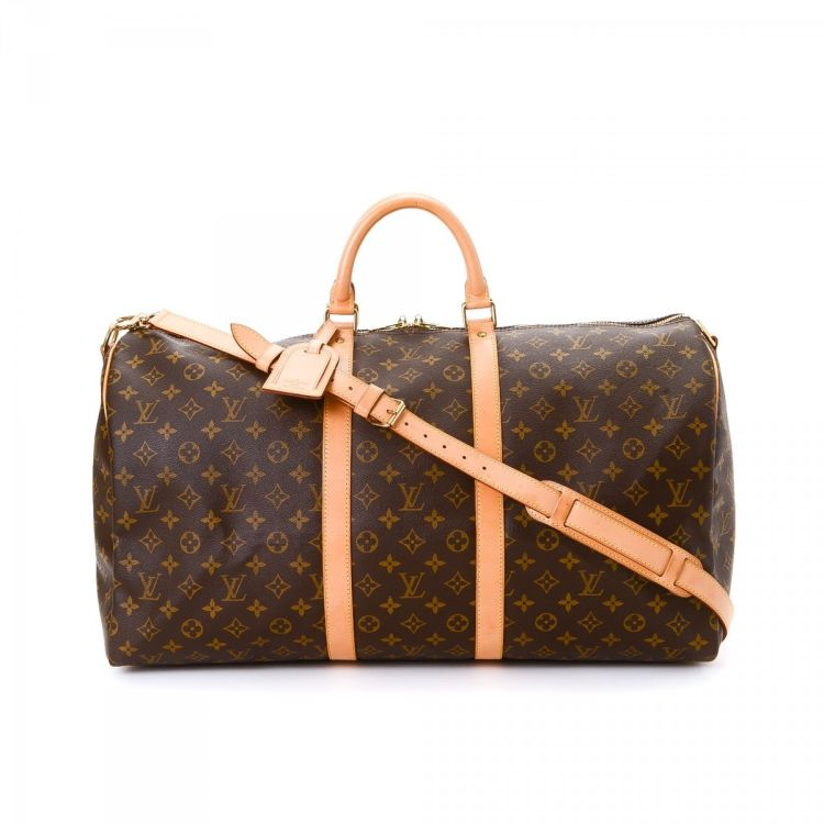bd7452f71cf8 LXRandCo guarantees the authenticity of this vintage Louis Vuitton Keepall  Bandouliere 55 travel bag. This sophisticated garment bag was crafted in  monogram ...