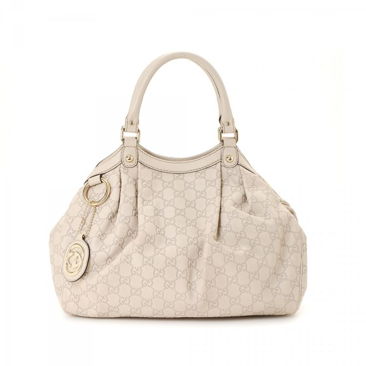 5479da5d864e2e LXRandCo guarantees this is an authentic vintage Gucci Sukey Bag tote. This  beautiful tote in ivorie is made in guccissima leather.