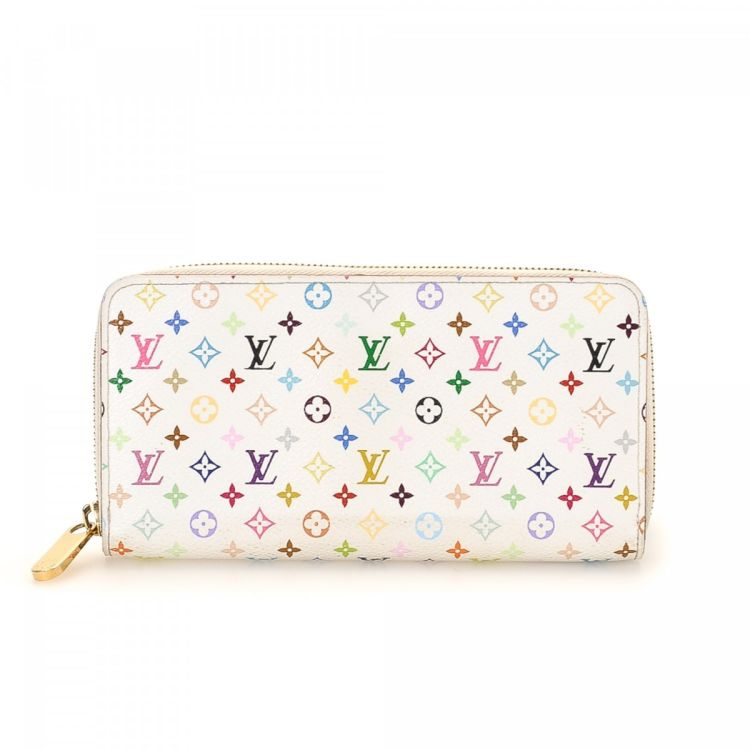 2a742aff55f9 LXRandCo guarantees this is an authentic vintage Louis Vuitton Zippy wallet.  This iconic bifold was crafted in monogram multicolore coated canvas in  white.