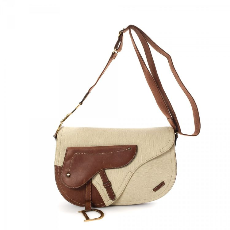 The authenticity of this vintage Dior Saddle Bag messenger   crossbody bag  is guaranteed by LXRandCo. This everyday messenger   crossbody bag comes in  cream ... f78c700cd72cb