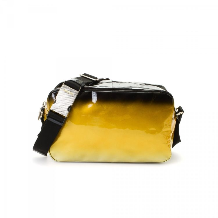 c6d6b9452a7234 ... vintage Prada Crossbody Bag messenger & crossbody bag is guaranteed by  LXRandCo. This sophisticated pocketbook in two-tone is made of patent  leather.