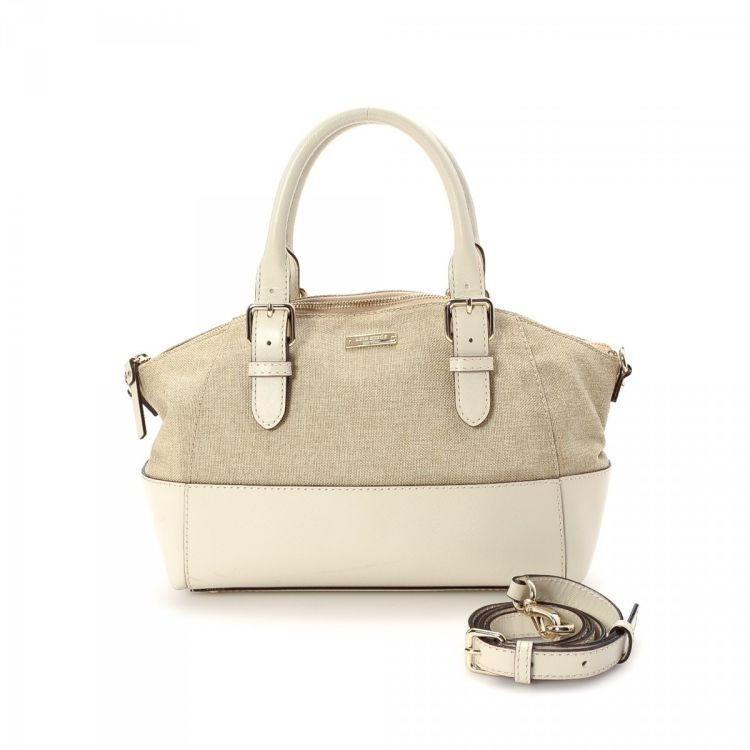 bbe7fbfe3e LXRandCo guarantees this is an authentic vintage Kate Spade Charlotte Street  Fabric Small Sloan tote. This luxurious work bag in beige is made of canvas.