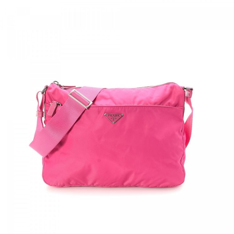 0a4be873e966 LXRandCo guarantees the authenticity of this vintage Prada Vela Crossbody  Bag messenger & crossbody bag. This practical pocketbook comes in pink nylon .
