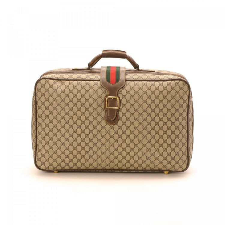 7818b8e2748 LXRandCo guarantees this is an authentic vintage Gucci Web Suitcase travel  bag. This practical baggage in brown is made in gg supreme coated canvas.