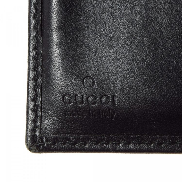 fa0f7e0e09a The authenticity of this vintage Gucci wallet is guaranteed by LXRandCo.  This classic wallet was crafted in web canvas in beautiful black.
