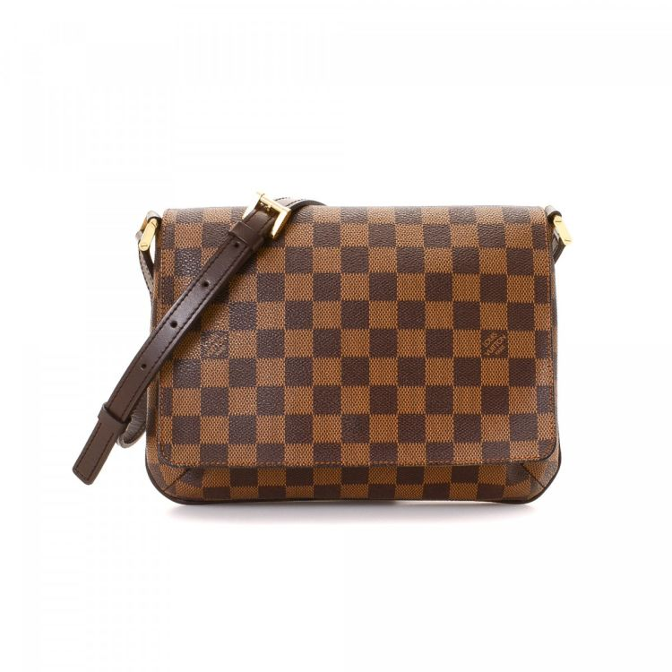 1de9acf99476 ... this vintage Louis Vuitton Musette Tango Long Strap messenger    crossbody bag. This luxurious saddle bag in brown is made in damier ebene  coated canvas.