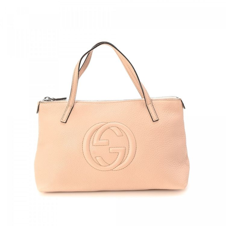 bc91f3fe3530 LXRandCo guarantees the authenticity of this vintage Gucci Kids SOHO Tote  handbag. This everyday pocketbook was crafted in leather in light pink.