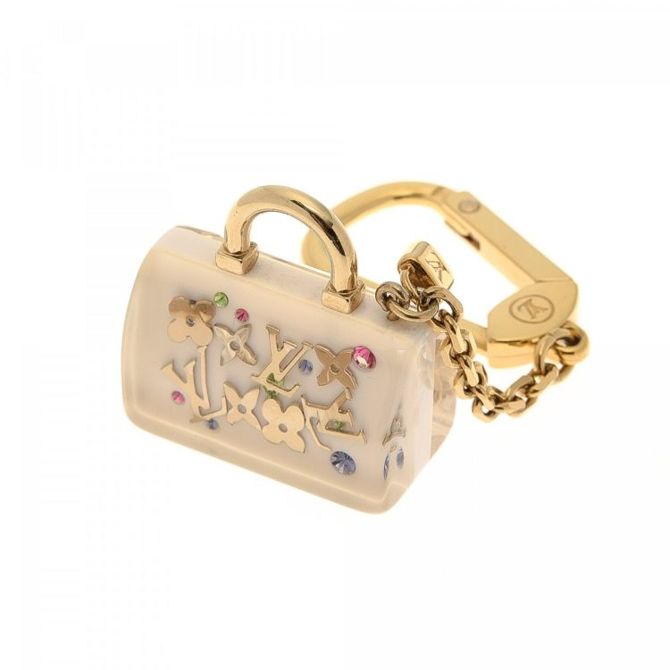 7f17a4b233f5 LXRandCo guarantees this is an authentic vintage Louis Vuitton Speedy  Inclusion Key Ring or Bag Charm. This iconic accessory was crafted in resin  in gold ...