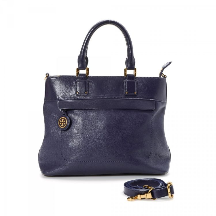 a60dca56198 LXRandCo guarantees this is an authentic vintage Tory Burch Two Way Bag tote.  This chic tote bag comes in purple leather. Due to the vintage nature of  this ...