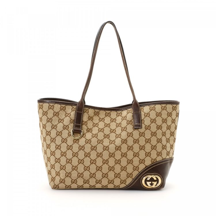 f0c67d4446c3 LXRandCo guarantees this is an authentic vintage Gucci New Britt tote. This  elegant tote in brown is made in gg canvas. Due to the vintage nature of  this ...