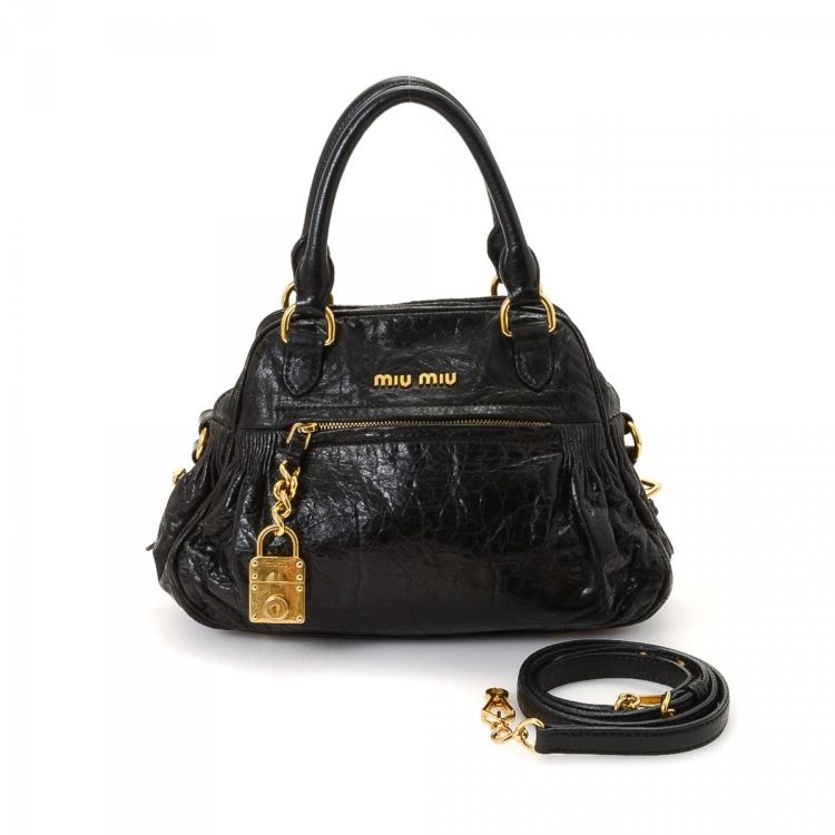 9d58a67dcd7 The authenticity of this vintage Miu Miu Nappa Charm Two Way Bag shoulder  bag is guaranteed by LXRandCo. This signature purse was crafted in leather  in ...