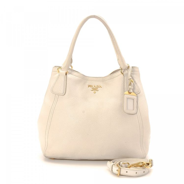 c3b20f7717d3 LXRandCo guarantees this is an authentic vintage Prada Two Way Bag tote.  This beautiful large handbag comes in ivorie leather. Due to the vintage  nature of ...