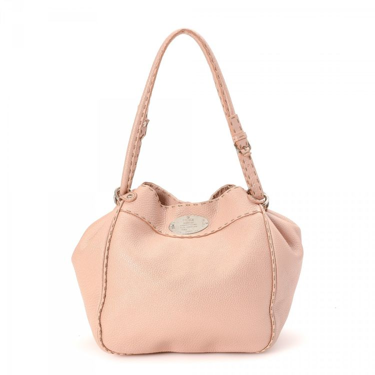 c1922c75b9a6 The authenticity of this vintage Fendi Selleria Pink Bag tote is guaranteed  by LXRandCo. This beautiful bag was crafted in leather in baby pink.
