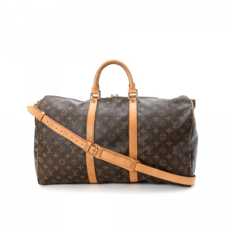 63ffa94ace05 ... authentic vintage Louis Vuitton Keepall 50 Bandouliere travel bag.  Crafted in monogram coated canvas