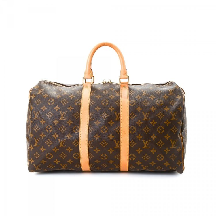 5af9acc5ad02 LXRandCo guarantees this is an authentic vintage Louis Vuitton Keepall 45  travel bag. Crafted in monogram coated canvas