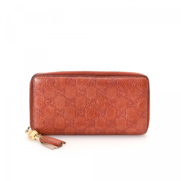 ad896e2c07f7 The authenticity of this vintage Gucci Bamboo Tassel Zip Around wallet is  guaranteed by LXRandCo. This lovely bifold in beautiful pink is made in  guccissima ...