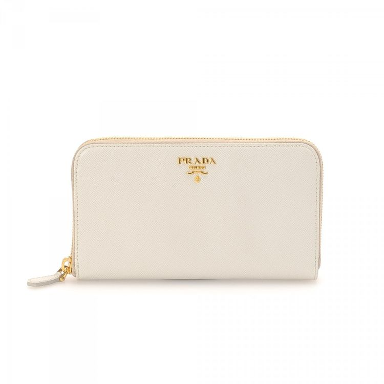 ac72facbc1 LXRandCo guarantees the authenticity of this vintage Prada Zip Around wallet.  This exquisite compact wallet was crafted in leather in beautiful white.