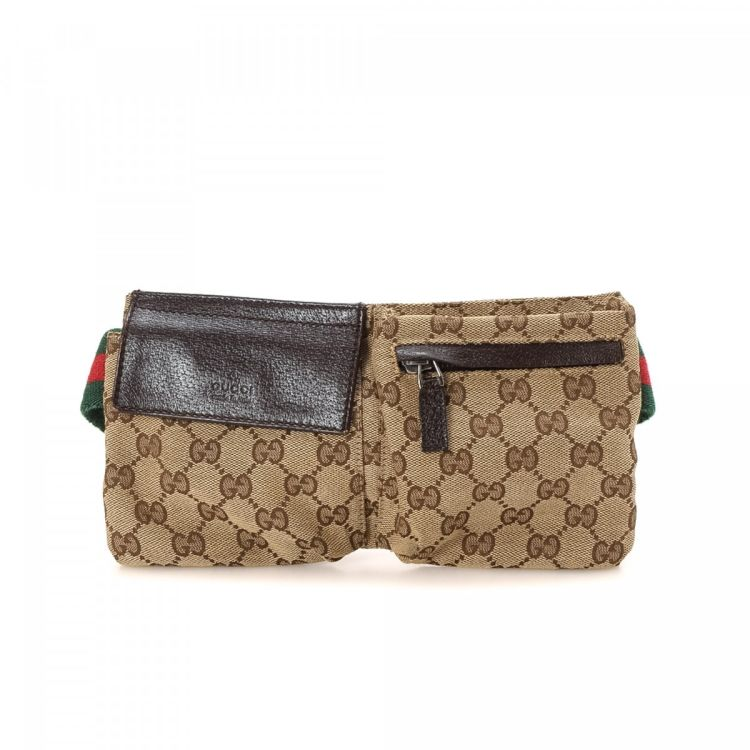 61cd80528356 LXRandCo guarantees the authenticity of this vintage Gucci Belt Bag vanity  case & pouch. This iconic pouch in brown is made in gg canvas.