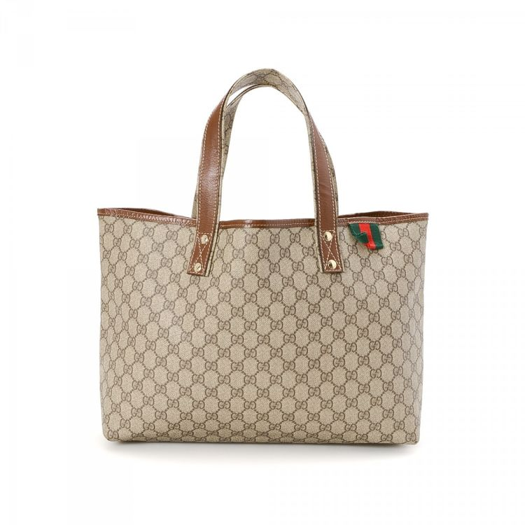 7ee6bf0f7cfd LXRandCo guarantees the authenticity of this vintage Gucci Signature Web  tote. This elegant bag in beautiful brown is made in gg canvas.
