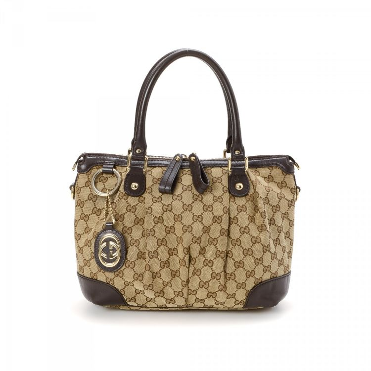e633b3de7354 LXRandCo guarantees the authenticity of this vintage Gucci Sukey Tote  shoulder bag. Crafted in gg canvas, this sophisticated bag comes in brown.
