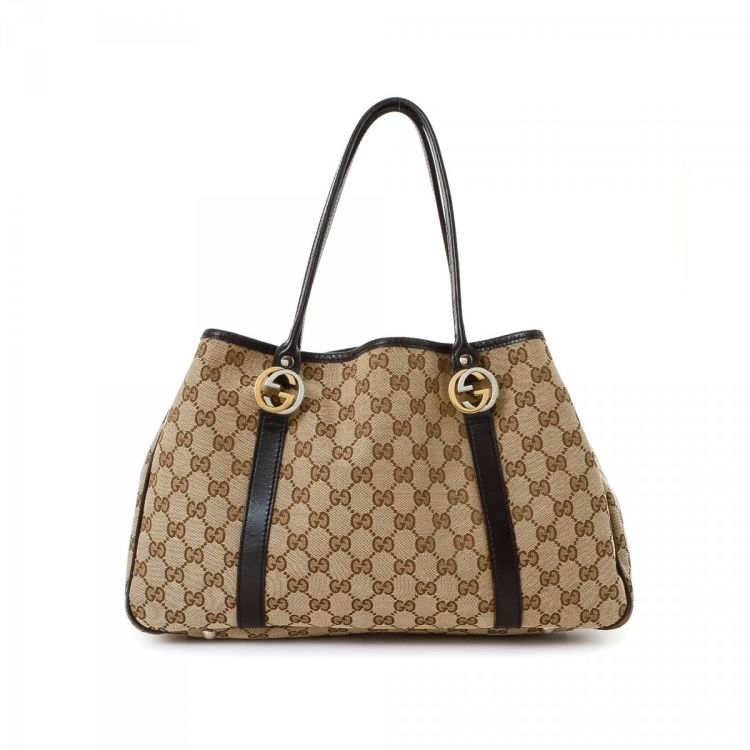 9d55c1a7c66 LXRandCo guarantees the authenticity of this vintage Gucci tote. This  luxurious tote bag was crafted in gg canvas in brown. Due to the vintage  nature of ...