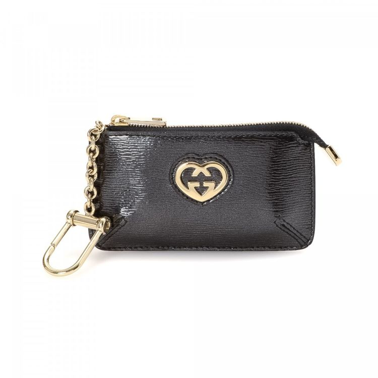 e7ee82623e3e LXRandCo guarantees this is an authentic vintage Gucci Lovely Heart Key  Chain Coin Case wallet. Crafted in leather, this iconic bifold comes in  beautiful ...