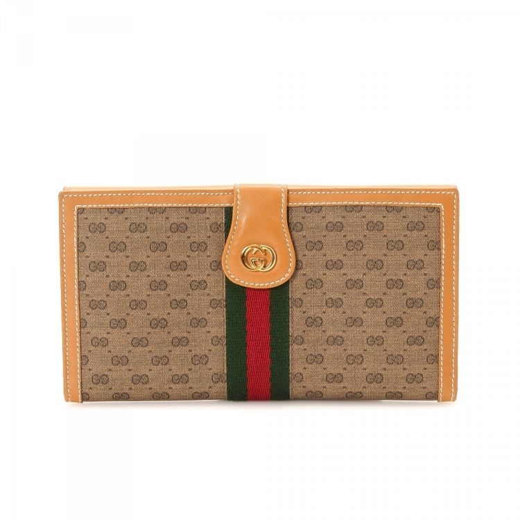 8f32b5efd2fd80 LXRandCo guarantees this is an authentic vintage Gucci Sherry Web wallet.  Crafted in gg canvas, this stylish bifold comes in beautiful tan.