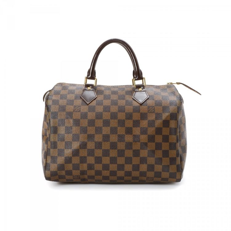 50ca13a49abc LXRandCo guarantees the authenticity of this vintage Louis Vuitton Speedy 30  handbag. This exquisite bag was crafted in damier ebene coated canvas in  brown.