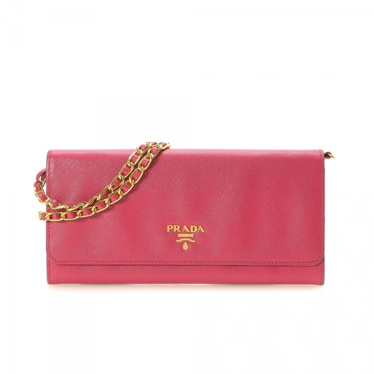 4cace3661cf3a8 LXRandCo guarantees this is an authentic vintage Prada Chain wallet. This  refined slimfold in beautiful pink is made in saffiano lux leather.