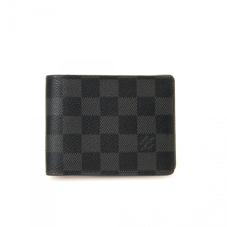 8f1ad72f2f24 The authenticity of this vintage Louis Vuitton Multiple wallet is  guaranteed by LXRandCo. This sophisticated bifold was crafted in damier  graphite coated ...
