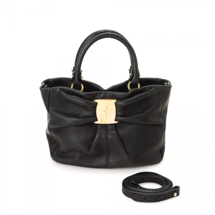 LXRandCo guarantees the authenticity of this vintage Ferragamo Vara Bow Two  Way Bag tote. This lovely work bag in black is made of leather. a31fe740ba355