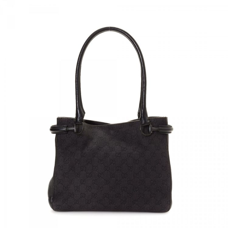 b3b759cd6a20 The authenticity of this vintage Gucci Horsebit Bag tote is guaranteed by  LXRandCo. This iconic tote bag was crafted in gg denim in black.