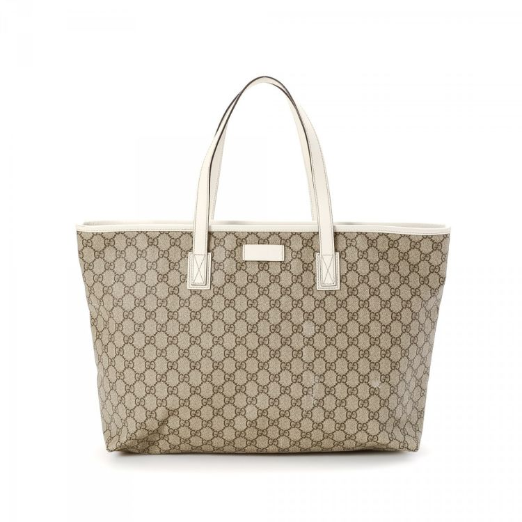 bfb44131ef20 LXRandCo guarantees the authenticity of this vintage Gucci Joy tote.  Crafted in gg coated canvas, this sophisticated tote bag comes in beige.