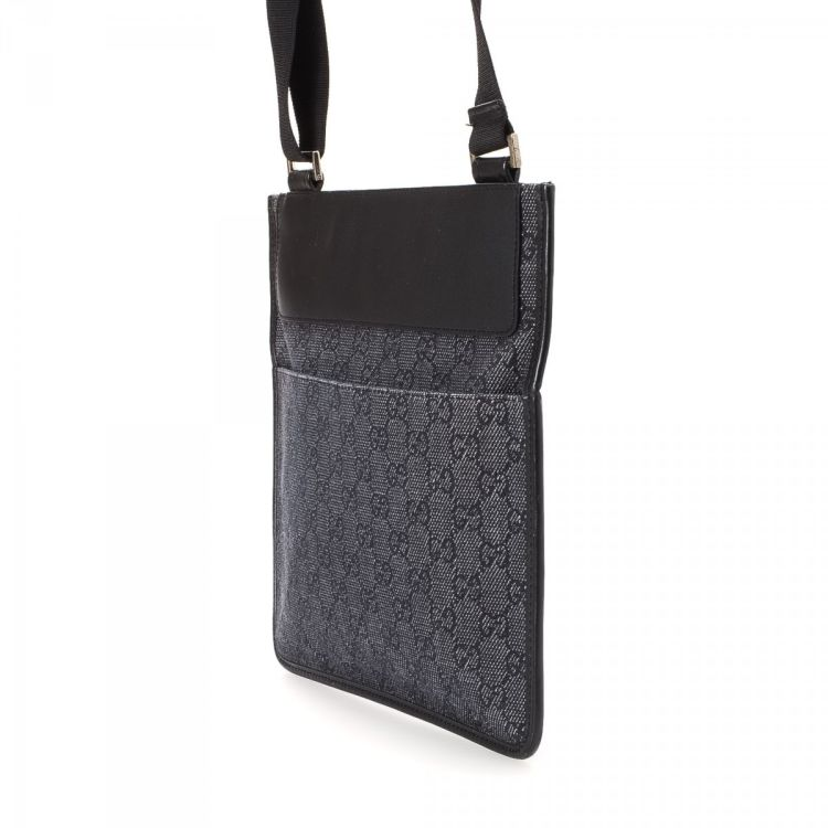 3e0119229b56 LXRandCo guarantees this is an authentic vintage Gucci Crossbody Bag  messenger   crossbody bag. This luxurious saddle bag in black is made in gg  denim.