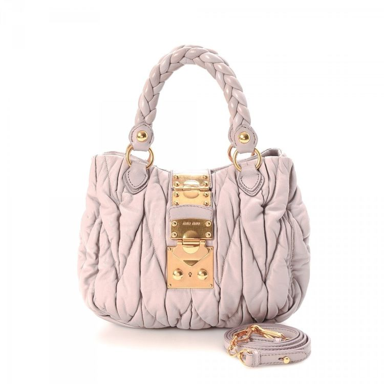 e74335965129 LXRandCo guarantees this is an authentic vintage Miu Miu Bauletto Aperto Bag  handbag. This classic handbag in beautiful baby pink is made in matelasse  lux ...