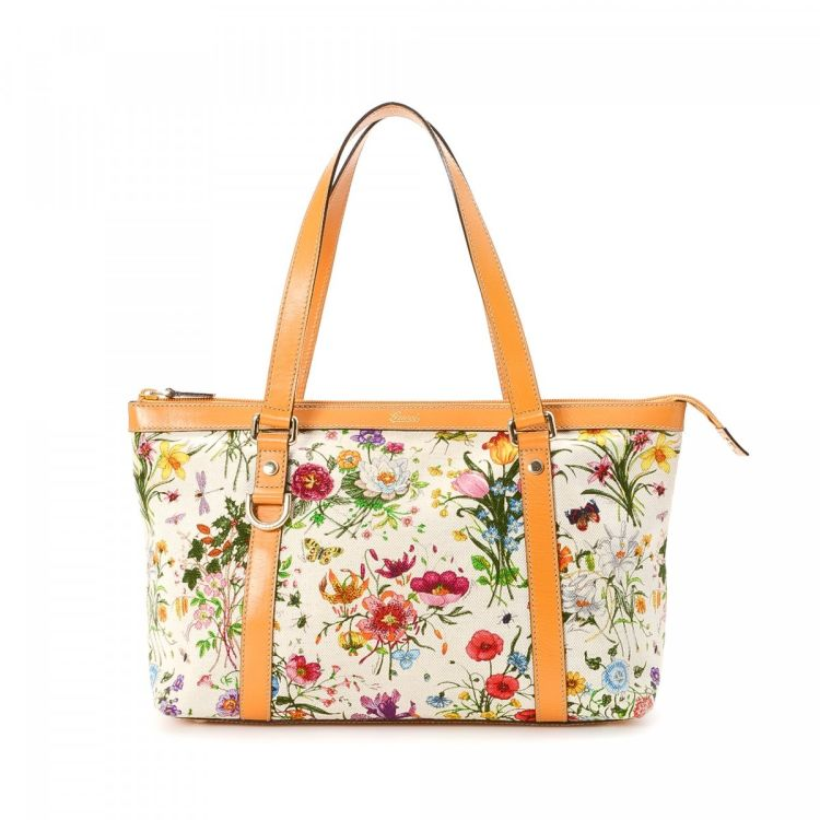 58d3ea816ae5 LXRandCo guarantees the authenticity of this vintage Gucci tote. Crafted in  canvas, this lovely bag comes in multi color. Due to the vintage nature of  this ...