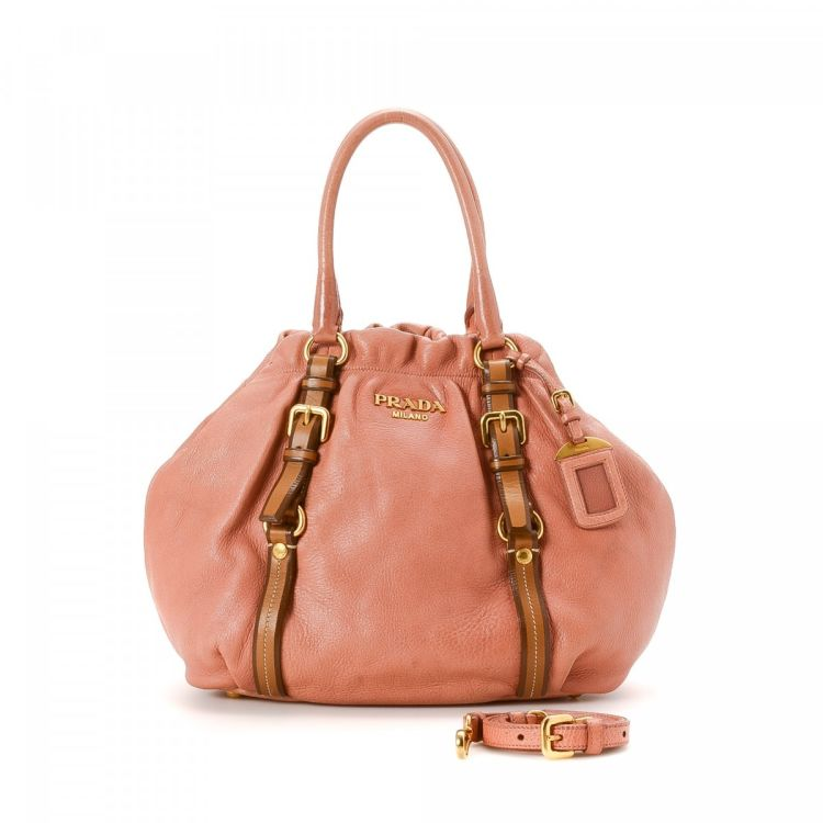3b7ff1f34d50 The authenticity of this vintage Prada Two Way Hobo Bag shoulder bag is  guaranteed by LXRandCo. This classic purse was crafted in leather in pink.
