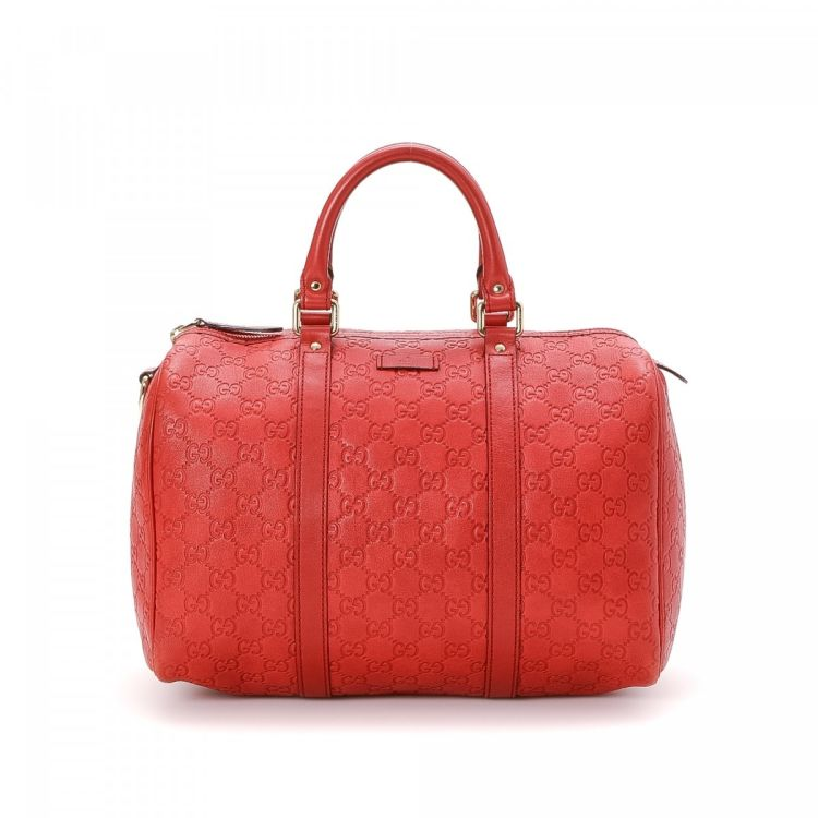 ddda680f702a LXRandCo guarantees the authenticity of this vintage Gucci Joy Boston Bag  travel bag. This everyday weekender in red is made in gg leather.