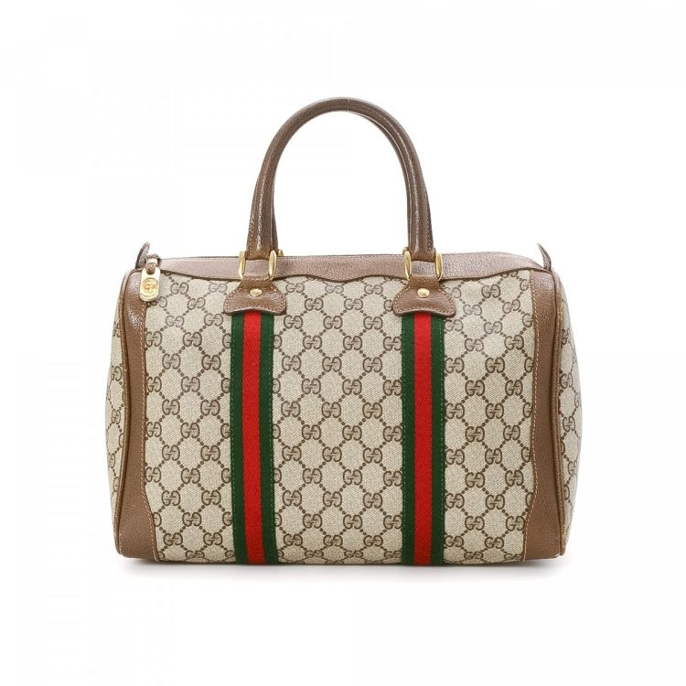 5328cdb11c4 The authenticity of this vintage Gucci Classic Web Boston Bag travel bag is  guaranteed by LXRandCo. This exquisite carry on was crafted in gg canvas in  ...