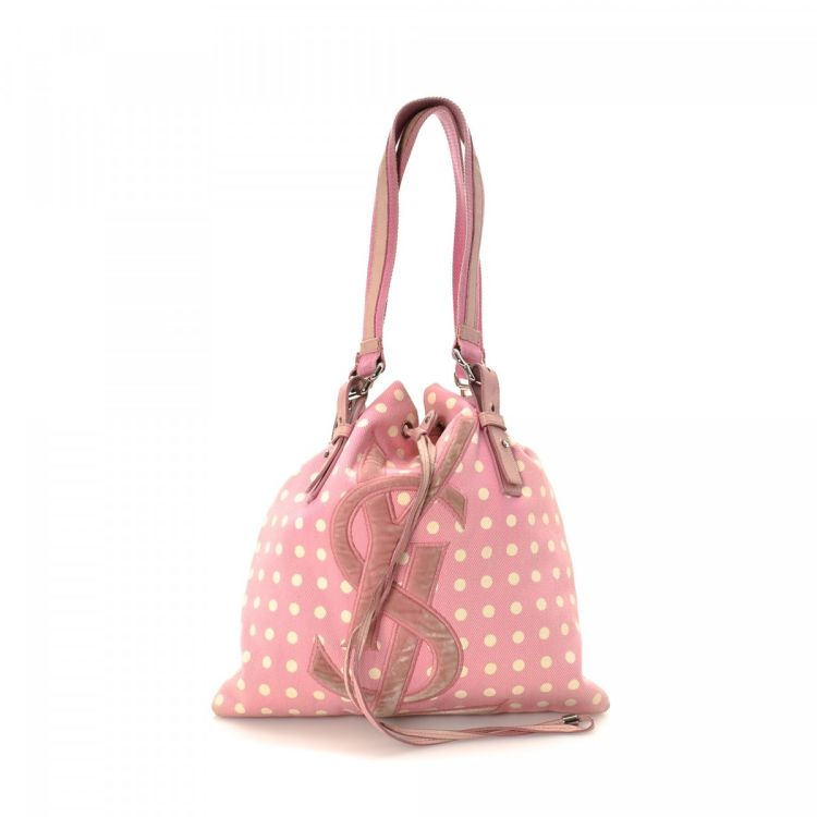 a86df7da617 The authenticity of this vintage Yves Saint Laurent Kahala shoulder bag is  guaranteed by LXRandCo. This classic purse in pink is made of canvas.