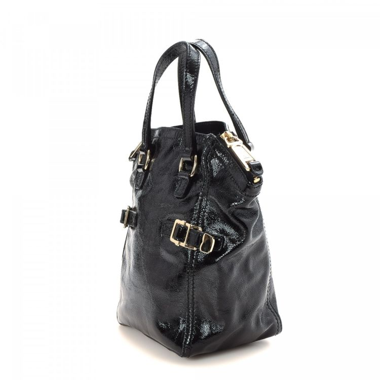 569e4849af5 ... guarantees the authenticity of this vintage Yves Saint Laurent Mini  Downtown tote. This everyday bag was crafted in patent leather in beautiful  black.