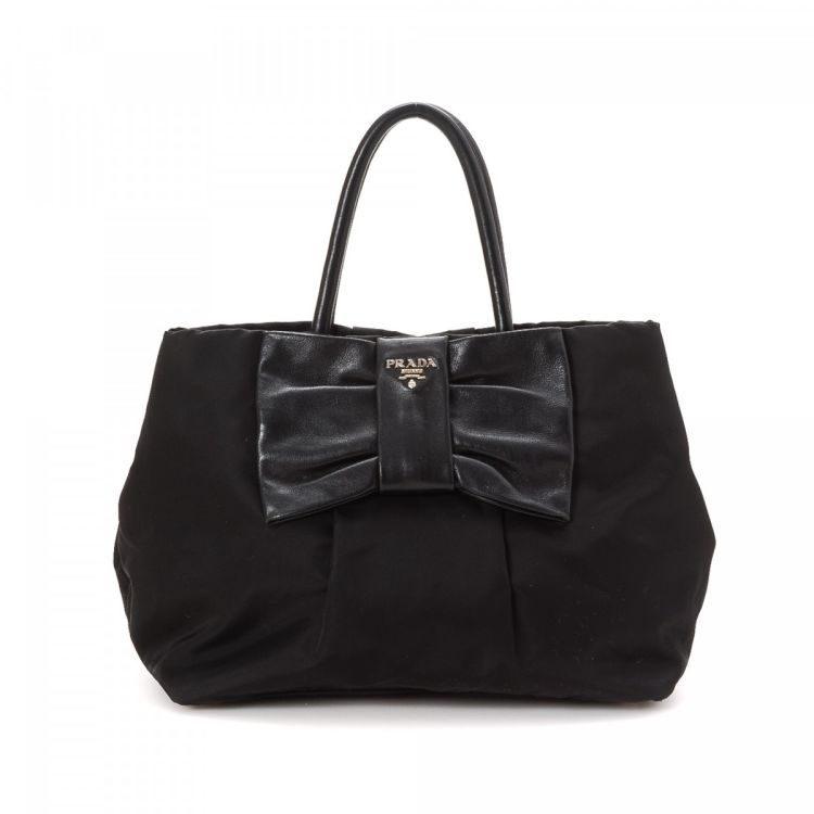 73a4a0f82fa3 LXRandCo guarantees this is an authentic vintage Prada Nappa Small tote.  Crafted in tessuto nylon