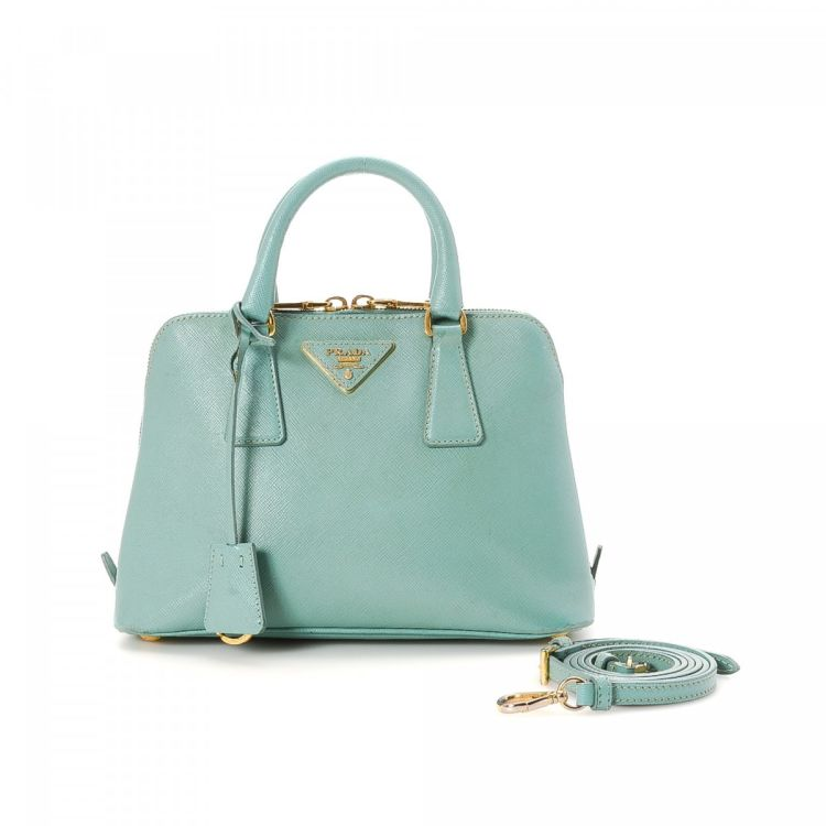 24946ae7ae3d LXRandCo guarantees this is an authentic vintage Prada Two Way Bag handbag.  This exquisite purse in baby blue is made in saffiano leather.