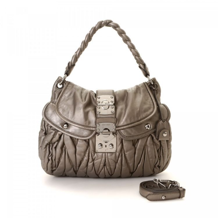 d009b5e595d7 The authenticity of this vintage Miu Miu Two Way Bag shoulder bag is  guaranteed by LXRandCo. This beautiful bag in silver tone is made of calf.