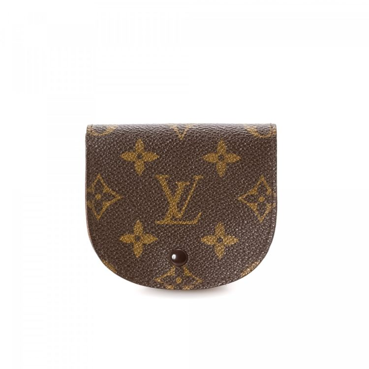 70c327445c7cb LXRandCo guarantees this is an authentic vintage Louis Vuitton Coin Purse  wallet. This everyday compact wallet was crafted in monogram coated canvas  in ...