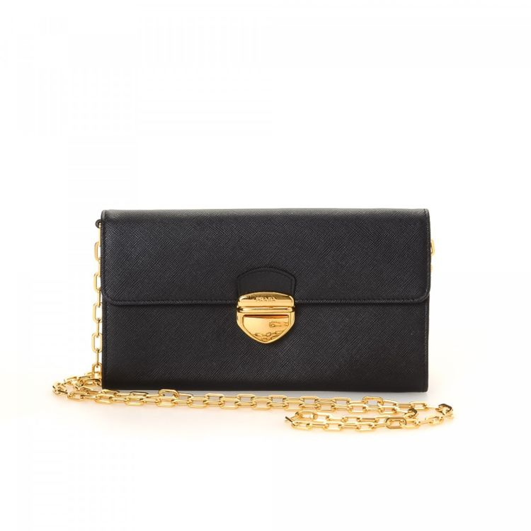 e7262b530176 LXRandCo guarantees this is an authentic vintage Prada Shoulder Pouch  shoulder bag. This sophisticated bag was crafted in saffiano leather in  black.