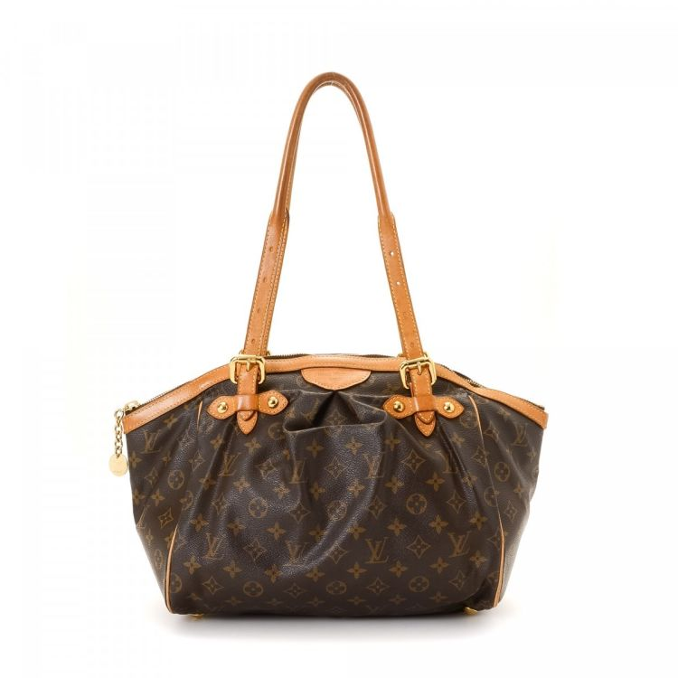 9bfa5f023cfd LXRandCo guarantees this is an authentic vintage Louis Vuitton Tivoli GM  shoulder bag. Crafted in monogram coated canvas