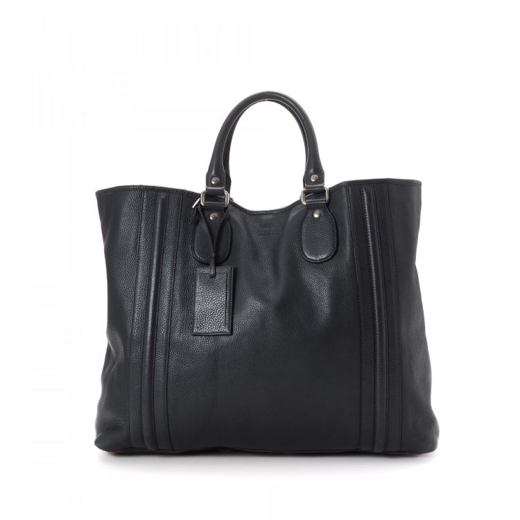 c318315fd0ef8c LXRandCo guarantees this is an authentic vintage Gucci Bag tote. Crafted in  leather, this luxurious work bag comes in black. Due to the vintage nature  of ...