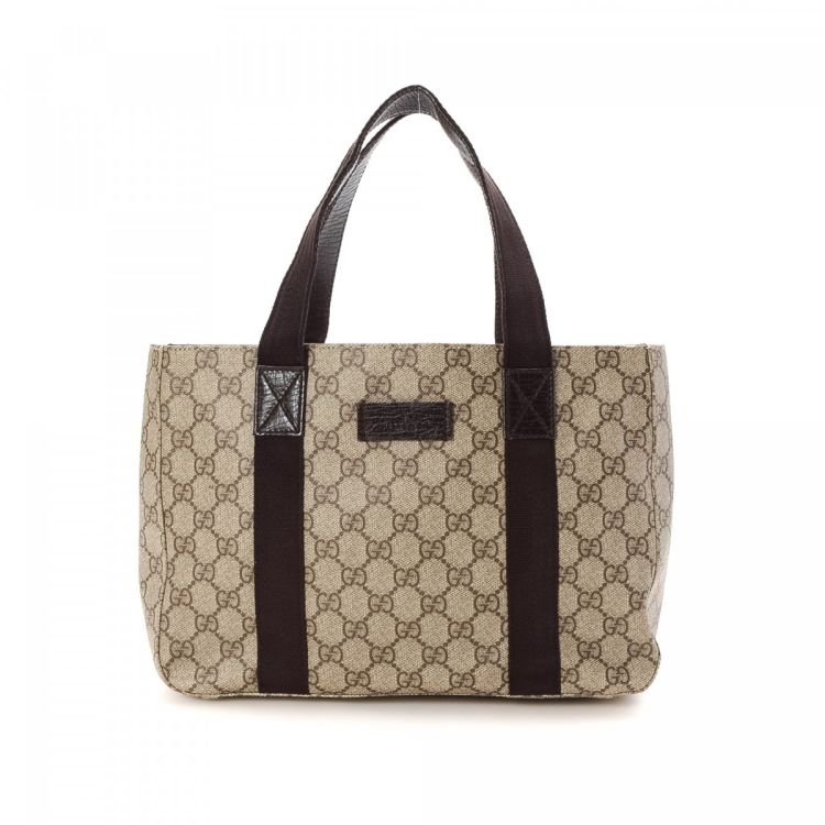 e10c0a54d4fc The authenticity of this vintage Gucci Bag tote is guaranteed by LXRandCo.  Crafted in gg coated canvas, this exquisite bag comes in beige.